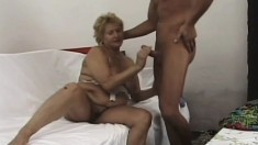 Lustful mature blonde with big boobs has a stud fucking her holes like she deserves