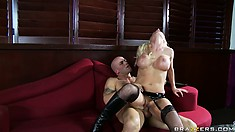 Blonde with fake tits, wearing black lingerie, gets on top of hard cleaver
