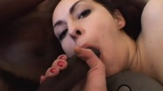 An excited young whore has one white and one black cock to taste