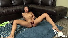 Yasmine sucks on her dildo, gets naked and jams it in her trimmed slit