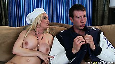 Bending on the sofa, she gets her tiny holes fucked from behind and covered with cum