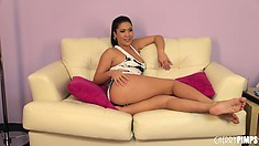 Sexy brunette London Keyes chats on the couch during an interview