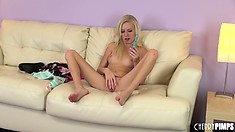 Elaina sits on the couch and diddles her clit, then gets her toy