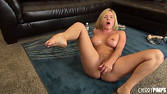 Krissy gets oiled up and starts toying her trimmed pussy on the floor