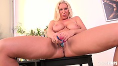 Busty blonde mom, Devon Lee, fingers and toys her naughty love hole