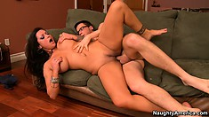 The stacked brunette has the young stud fulfilling all her desires on the couch