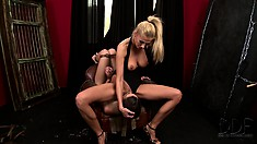 Blindfolded, the sexy brunette has a hot blonde with nice tits fisting her tight ass