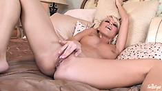 Luscious blonde gets going on her hot body and does some finger fucking