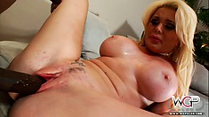 Voluptuous blonde lady with huge tits has a black prick fucking her tight pussy deep