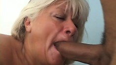 The blonde milf gives him a great blowjob and gets spoon fucked hard on the bed