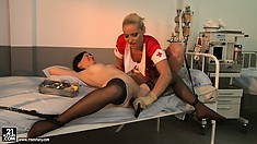 Back at the hospital, the blonde nurse pokes and prods the brunette patient