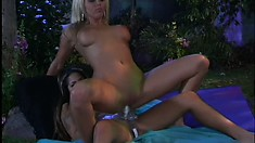 Sexy blonde goddess toys her twat in the twilight zone then rides a strap-on