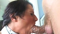 Gorgeous babe works her sexy lips all over that huge cock until it bursts in her mouth