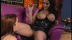 Busty lesbians with a thing for tight leather bang each other