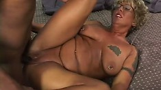 Naughty short-haired granny gets smashed by a thick black dong