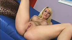 Sexy blond strips naked and jacks him off all over her fake tits