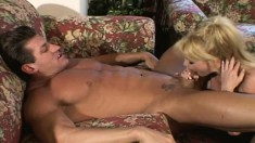 Long-haired blonde bimbo rides on her partner's mighty schlong