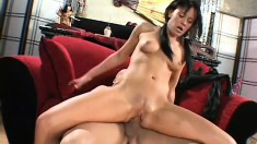 A dark haired teen adores having her pussy filled up with meat