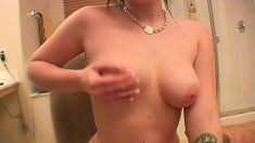 Seductive brunette Andi sends her hands sensually caressing her boobs