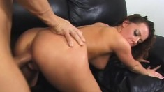 Exciting brunette with big tits plays with a huge dildo before enjoying a hard cock