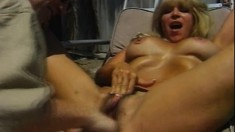 Slutty blonde cougar with big tits gets fucked by the pool boy outside