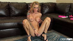 Sarah fingers her twat spread wide and gets on the floor to toy
