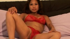 Sexy Nalani sits in her red underwear on the bed showing her stuff