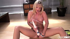 Blonde hottie Tristyn Kennedy sits on the floor toying and vibrating