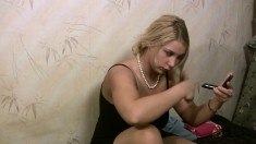 Stacked blonde in pantyhose peels off her black dress and masturbates