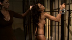 Tanned beauty gets herself tied up and used by a horny dominatrix
