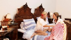 Pigtailed lesbians get rid of their clothes and have fun on the bed