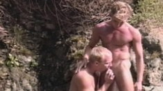 Sexy studs Jason and Kip suck each other's rods and fuck hard outside