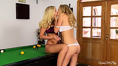 Blond girls get up on the pool table and get it on with each other