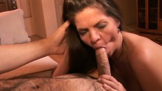 Huge breasted June Summers blows a big stick and then wildly fucks it