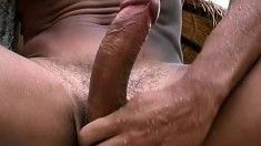 Latino dude with a chiseled body showers outside and jerks his rod