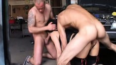 Wild milf gets double penetrated by two horny mechanics in the garage