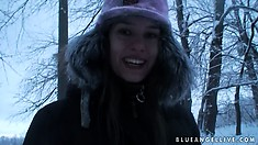 Fine european babe takes a walk through the woods during winter
